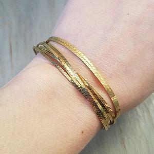 Gold toned multi strand bracelet